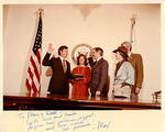 Max Baucus taking the oath of office, with family by Creator unknown