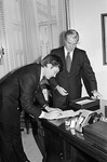 Max Baucus signing oath of office by Creator unknown