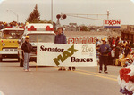 Max Baucus walking in parade by Creator unknown