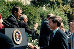 Ronald Reagan and Max Baucus by Creator unknown
