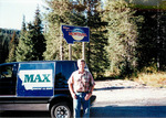 Max Baucus on walking campaign, in front of van by Creator unknown