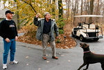 Max Baucus throws ball for Buddy, Clinton family dog by Creator unknown
