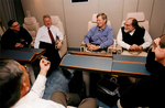 Bill Clinton, Max Baucus, and others on Air Force One by Creator unknown