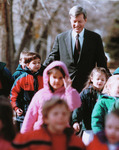 Max Baucus walking with kindergarteners to Montana State Legislature by Creator unknown
