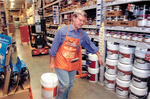 Max Baucus at Home Depot workday event by Creator unknown