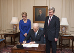 Melodee Hanes, Max Baucus, and Joe Biden at ambassadorial swearing-in ceremony by Creator unknown