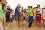 Max Baucus releasing endangered sea turtle by Creator unknown