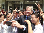 Max Baucus with schoolgirls by Creator unknown