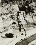 Mike Mansfield standing on a sluice box by Creator Unknown